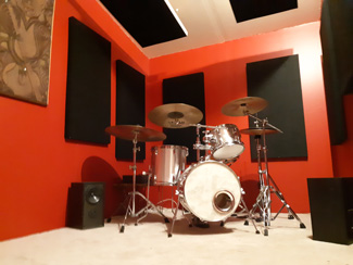 Acoustic wall panels and suspended sound cloud panels in new drum room